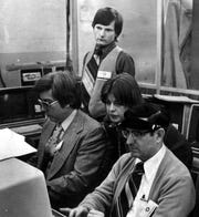 Mid-1970s: Times Assistant City Editor Joe Henry Wallace watches, from left, Sports Editor Gerry Robichaux, courts reporter Linda Farrar and Managine Editor Allan Lazarus learn how to work the Dymo Vegas terminals that marked the paper's shift from lead type and typewriters to phototypesetting and word processing.