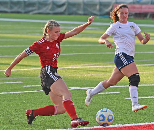 Yankton's Jaiden Boomsma, left, sends a shot to the goal during Thursday night's girls' soccer game against Tea Area at Crane-Youngworth Field.