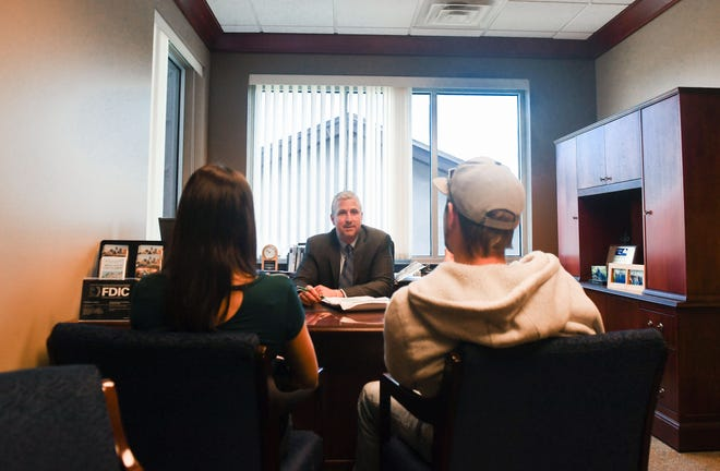 Keith Portner helps a couple with their finances on Monday, May 18, at Central Bank in Sioux Falls.