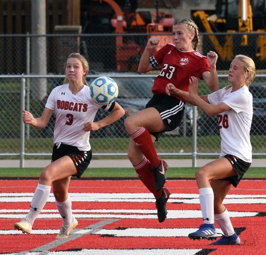 Brookings' Abby Ayres (3) and Alexis Schelske (28) try to keep Yankton's Jaiden Boomsma from getting to a ball in front of the net during their Eastern South Dakota Conference girls' soccer match on Tuesday at Yankton's Crane-Youngworth Field.
