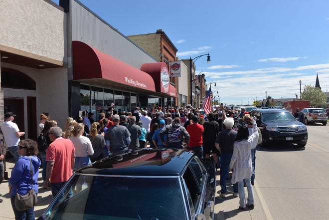 A large crowd gathered Monday at Shady's Restaurant in Albany as owner Kris Schiffler announced the tavern would not reopen due to a suit filed against it by the Minnesota Attorney General's Office.