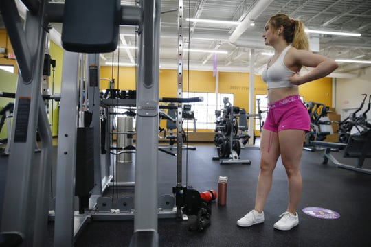 Andrea Campos works out at Anytime Fitness on Monday, May 18, 2020, at the Cimarron Market location on the West Side of El Paso.