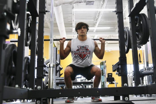 Jordan Strathmann works out at Anytime Fitness on Monday, May 18, 2020, at the Cimarron Market location on the West Side.