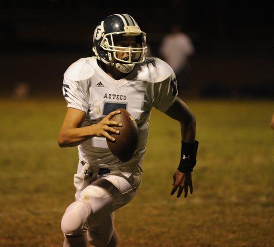 Farmersville's quarterback Sam Metcalf against Woodlake Friday night at Woodlake High on Sept. 16, 2011.