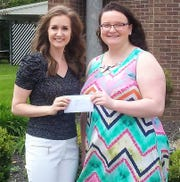 Libby Pratt of Bishop Rosecrans is presented a $500 scholarship from Michelle Garber of the Knights of Columbus Ladies.