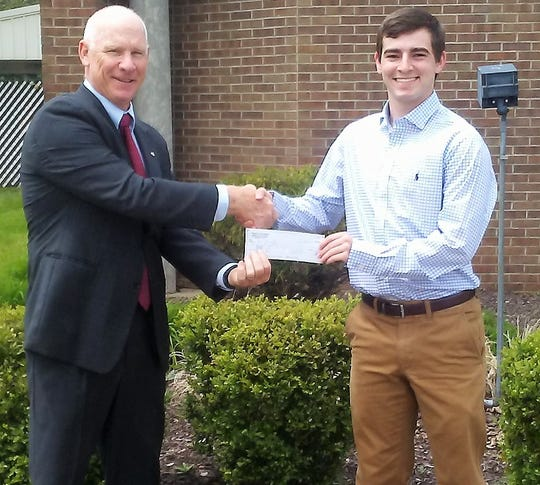 Hugh Maxwell of the Knights of Columbus presents a $500 scholarships to Will Bernath of Bishop Rosecrans High School.