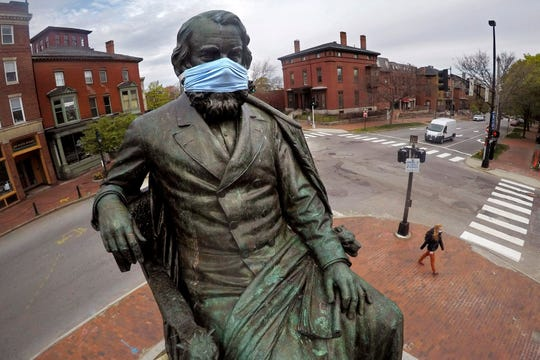 A statue of literary great Henry Wadsworth Longfellow wears a mask in Portland, Maine, May 18, 2020. There are 1,687 confirmed cases coronavirus in all of Maine's counties since the outbreak began in March, according to the Maine Center for Disease Control and Prevention. The statewide death toll is 70.