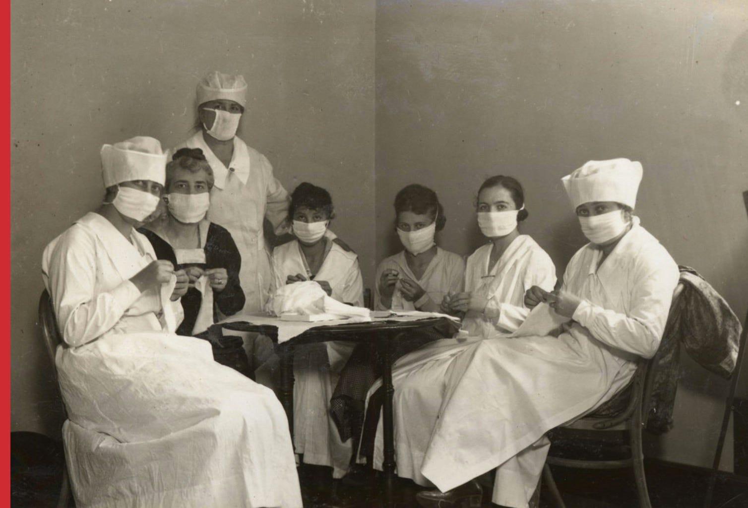Members of the War Camp Community Committee make flu masks, in San Francisco, in 1918.