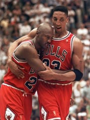 Michael Jordan in the arms of teammate Scottie Pippen at the end of Game 5 of the 1997 NBA Finals.