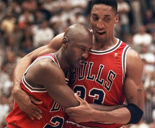 Michael Jordan collapses in the arms of teammate Scottie Pippen at the end of Game 5 of the 1997 NBA Finals.