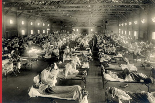 Soldiers in quarantine while recovering from the Spanish flu, at Camp Funston, Kansas in 1918.