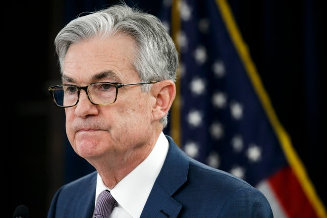 Federal Reserve Chair Jerome Powell expressed optimism on Sunday, May 17, 2020 that the U.S. economy can begin to recover from a devastating recession in the second half of the year, assuming the coronavirus doesn't erupt in a second wave. He's shown here during a March 3, 2020 news conference.