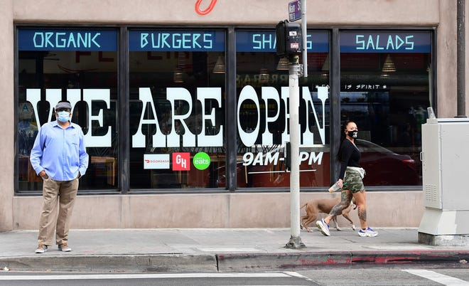 Restaurants in Los Angeles County were set to reopen Friday, the day barbershops and hair salons were cleared to open. The county has been hit the hardest in the state when it comes to coronavirus cases and related deaths.