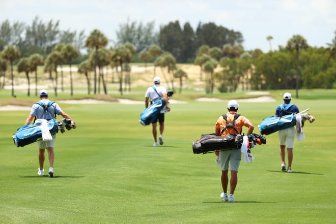 Rory McIlroy, Dustin Johnson, Rickie Fowler and Matthew Wolff walk down the first fairway during the TaylorMade Driving Relieve Supported By UnitedHealth Group on May 17 at Seminole Golf Club in Juno Beach, Florida.