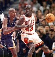 Michael Jordan is guarded by Reggie Miller during Game 7 of the 1998 Eastern Conference finals between the Bulls and Pacers.
