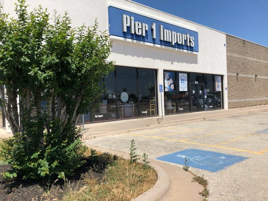 A sign on the door of the The Pier 1 Imports store in Abilene on Tuesday says the store is closed.