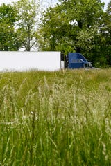 Tall grass surrounds a West Asheville exit along I-26 May 13, 2020.