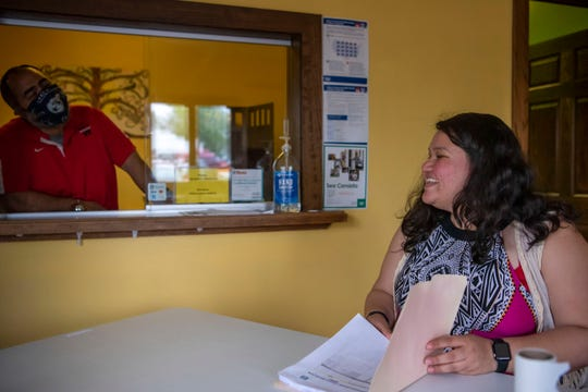 Voces Executive Director Jose Luis Orozco Jr. and Fernanda Reyes share a laugh on Tuesday, May 19, 2020 at their office in Battle Creek, Mich. Voces is a non-profit that serves the Latino and Hispanic community in Calhoun County.