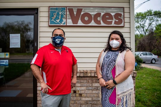 Voces Executive Director Jose Luis Orozco Jr. and Community Liaison Fernanda Reyes pose for a portrait on Tuesday, May 19, 2020 at their office in Battle Creek, Mich. Voces is a non-profit that serves the Latino and Hispanic community in Calhoun County.