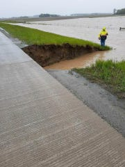 Flood waters have washed out a culvert under U.S. 30's eastbound lanes near Upper Sandusky. Those lanes are closed.