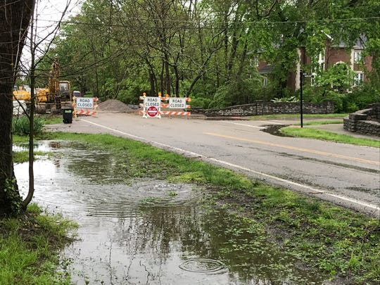 Water stands high early Tuesday afternoon after a morning deluge brought flooding to Glendale, including this area along East Sharon Road.