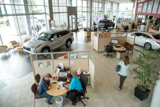 Customers and sales reps mingle in the main atrium at Wyatt Johnson Toyota in Clarksville, Tenn., on Monday, May 18, 2020.