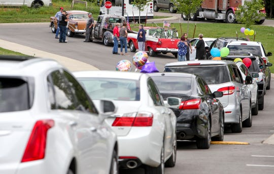 Cars line up in the back parking lot for a drive-by parade celebrating Velma Gilliam's 102nd birthday at Jubilee House in Clarksville, Tenn., on Monday, May 18, 2020.