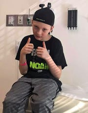 A tired, but resilient Nick Franks gives a thumbs up during a doctor's visit. His mother, Tanya Franks, said Nick has had a positive attitude during his fight against Hodgkin's Lymphoma.