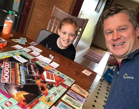 Nick Franks plays Monopoly with Pastor Neal Dearyan of Chili Crossroads Bible Church. The church will hold a pizza fundraiser for Nick and his family on May 27. Nick was diagnosed in January with Hodgkin's Lymphoma.