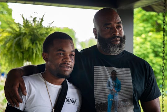 DarQuan Jones and his father, Daryl Jones Jr., pose for a portrait at a family residence on May 19, 2020. Jones, 22, was assaulted by three white men in the early morning of May 16 in an attack he and his family are saying was racially motivated, resulting in five facial fractures and a broken wrist. Jones said there was an attempt to drown him in a nearby creek, and at least one suspect repeatedly used racial slurs.