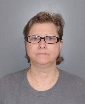 Michelle Boat, 55, shown in a mugshot. Boat of Pella has been charged with murder in the May 2020 death of 47-year-old Tracy Mondabough.