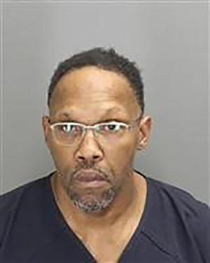 Leonard Harris, 51, a convicted murderer, was in possession of handguns, a police-style badge, police handcuffs, a handheld police scanner, and a plastic straw coated with cocaine.