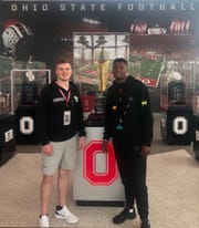 Ohio State quarterback commit Kyle McCord meets former Buckeye quarterback Dwyane Haskins during a recruiting visit on April 13, 2019, in Columbus, Ohio.