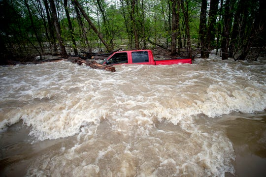 Tittabawassee Fire and Rescue rescued the driver from this red pickup truck on Norh Gleaner Road near its intersection with Tittabawassee Road on Tuesday, May 19, 2020 in Saginaw County, Mich. The truck was swept off of the road by standing water.