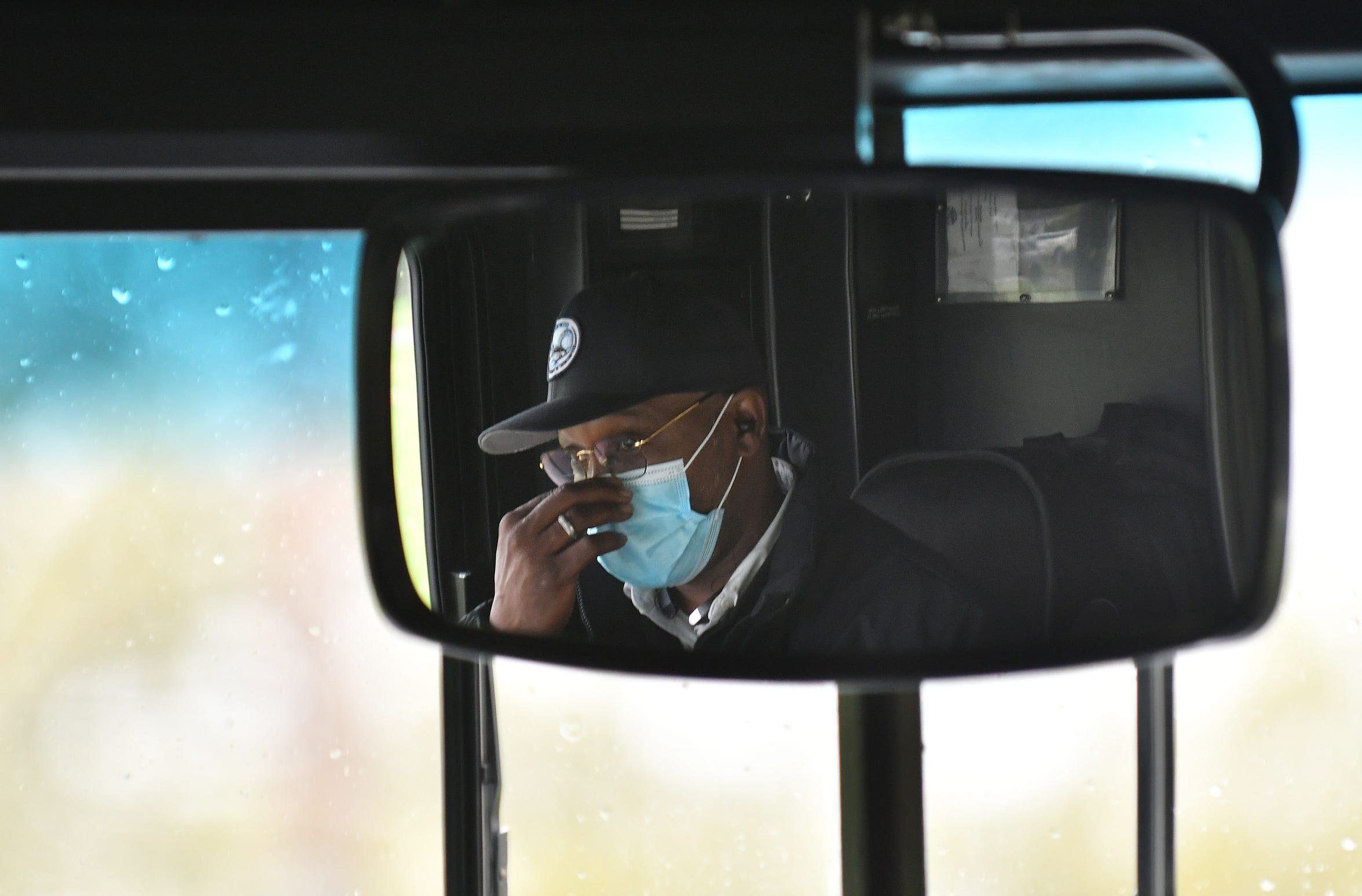 Andrew Love drives the 17 bus on Eight Mile Road in Detroit on May 18, 2020. To protect the health and safety of its customers and employees, DDOT is temporarily suspending fare collection for all trips and requesting that customers limit non-essential bus travel until further notice.