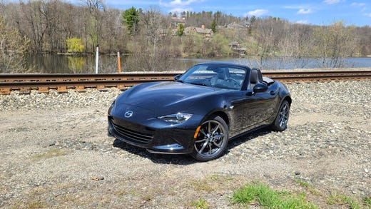 The 2020 Mazda MX-5 continues a 30-year Miata legacy of small, sub-2,500-pound cars that are fun on the track and off.