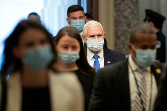 Vice President Mike Pence wears a face mask to protect against the spread of the new coronavirus as he arrives on Capitol Hill in Washington for a meeting with Senate Majority Leader Mitch McConnell of Ky., and Treasury Secretary Steve Mnuchin, Tuesday, May 19, 2020.