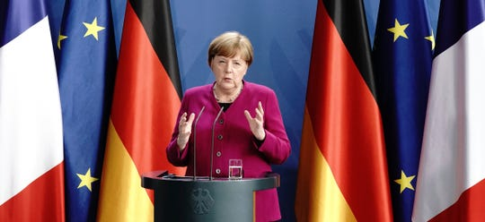 German Chancellor Angela Merkel speaks during a press conference following a joint video conference with French President Macron in Berlin, Germany, Monday, May 18, 2020.