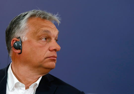Hungarian Prime Minister Viktor Orban listens to a question during a press conference after a meeting with Serbian President Aleksandar Vucic in Belgrade, Serbia, Friday, May 15, 2020.