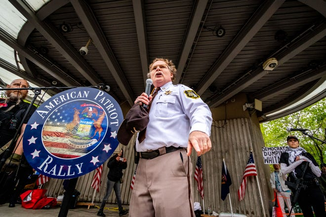 """Barry County Sheriff Dar Leaf addresses the crowd during the """"American Patriot Rally —Sheriffs Speak Out"""" event at Rosa Parks Circle in Grand Rapids, May 18, 2020. Leaf said that he will not enforce the governor's stay-at-home order stating it's unconstitutional."""