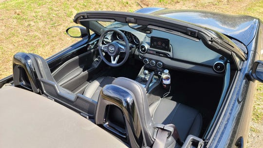 The cockpit of the 2020 Mazda MX-5 Miata. Manual and automatic 6-speeds are available, but the manual is particularly enjoyable for throwing the wee sports car around.