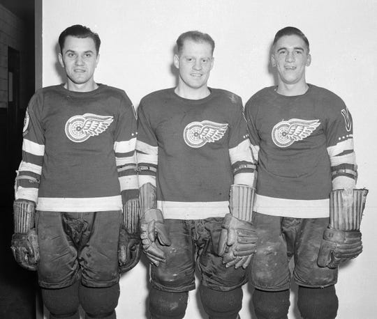 Red Wings forwards Steve (Wojciechowski) Wochy, from left, Jud McAtee and Ted Lindsay pose for a photo during the 1944-45 NHL season at Maple Leaf Gardens in Toronto. (Imperial Oil-Turofsky/Hockey Hall of Fame)
