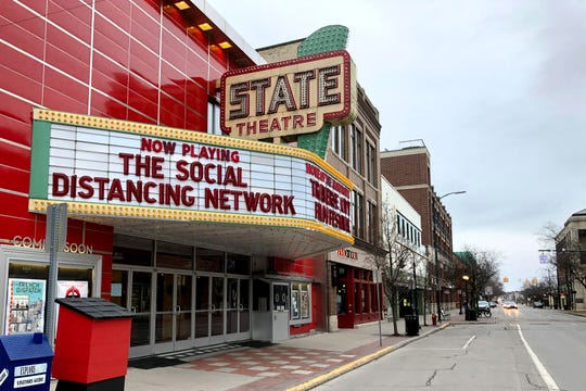 In this March 18, 2020, photo, a tongue-in-cheek message is displayed on the marquee of the State Theatre in Traverse City, Mich.