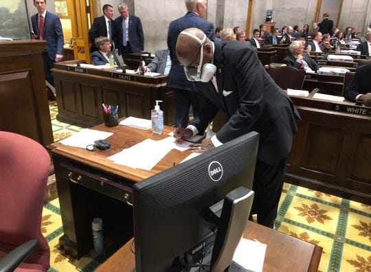 In this March 19, 2020 file photo State Rep. G.A. Hardaway, D-Memphis, wears a mask during House floor proceedings in Nashville, Tenn., amid the coronavirus pandemic.