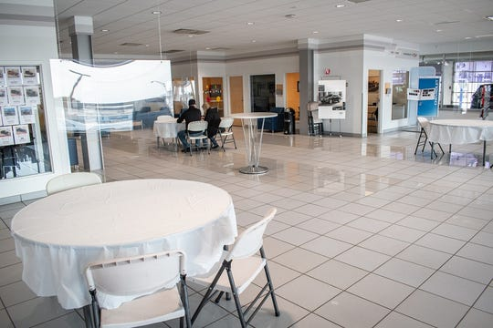 Holiday Automotive in Fond du Lac has cleared out its showroom and put in place circular tables with plexiglass down the middle to keep staff and customers safe during the coronavirus pandemic.