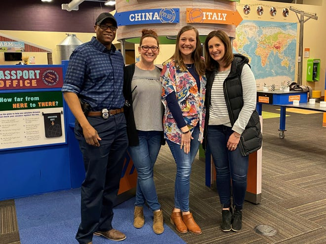 Pictured at the Fond du Lac Children's Museum is, from left, Museum board member, Keywon Brown, the museum's Education and Outreach Manager, Heather Sphatt, and Michelle Kulczewski with friend Andrea Nuss.