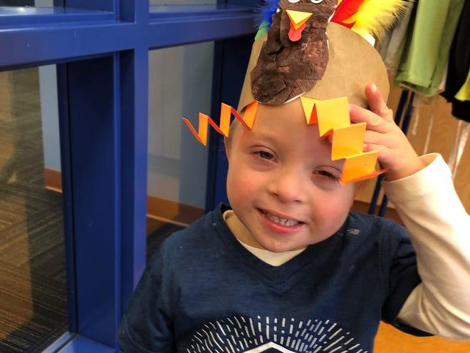 Malix Kulczewski wearing a turkey hat he made at the Children's Museum.