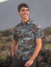FGCU graduate David Shepard in one of his shirts that features his hand-drawn Hawaiian botanical designs