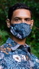 A model wears one of FGCU graduate David Shepard's botanical print masks.