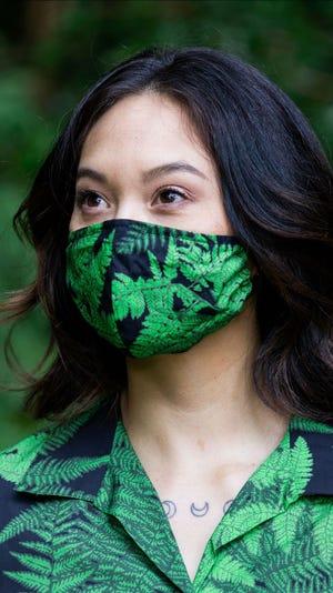 A model wears of of FGCU graduate David Shepard's  botanical print masks.